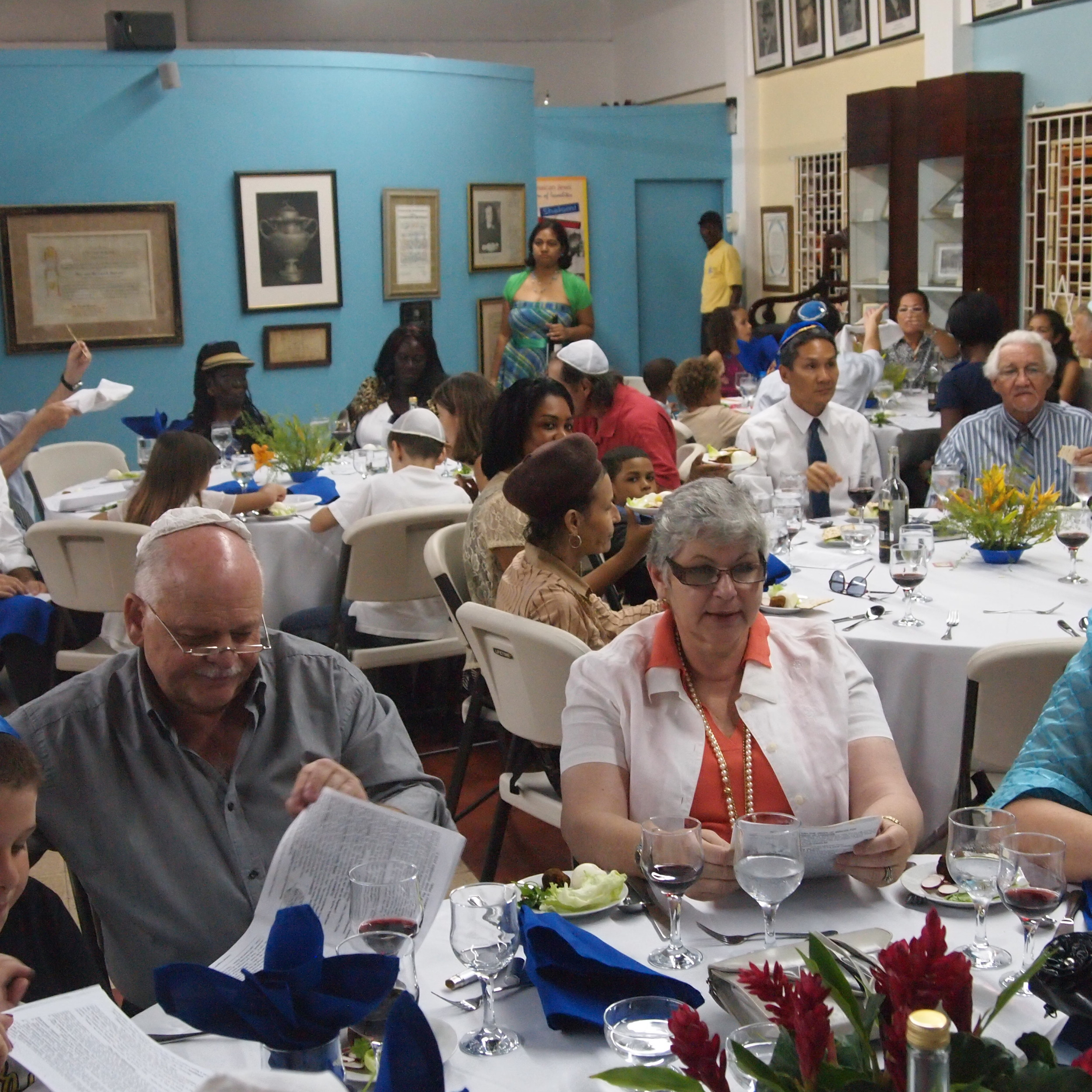 Click photo to download. Caption: This year's Passover seder organized by Shaare Shalom Synagogue of Kingston, Jamaica. Credit: Courtesy Rabbi Dana Evans Kaplan.