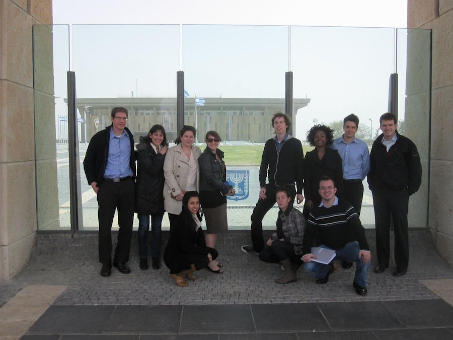 Click photo to download. Caption: Tel Aviv University and University of Chicago workshop participants outside the Knesset in Israel. Credit: Ronen Shnidman.