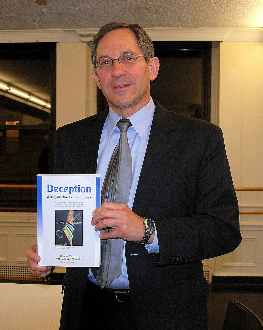 "Click photo to download. Caption: Itamar Marcus, director of Palestinian Media Watch, poses with his book, ""Deception: Betraying the Peace Process."" Credit: Maxine Dovere."