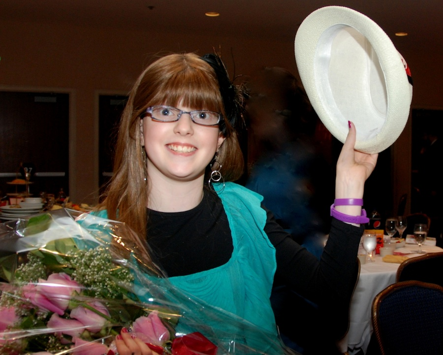 Click photo to download. Caption: Pink roses and a tip of the hat from cancer survivor Sari Ort, the youngest speaker at the Chai Lifeline 2012 Awards Dinner. Credit: Maxine Dovere.