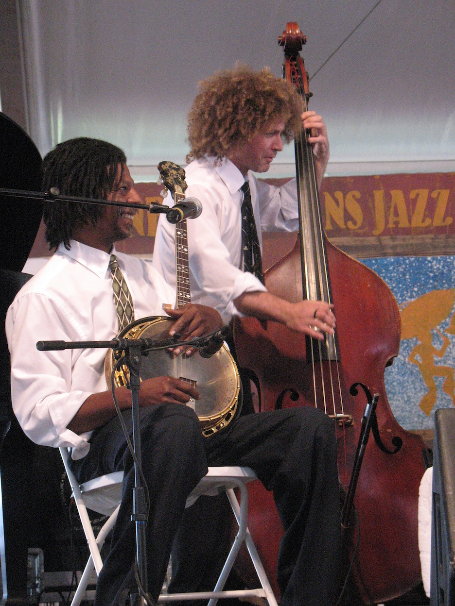 Click photo to download. Caption: The Preservation Hall Jazz Band at JazzFest 2008, featuring Carl LeBlanc on banjo and Ben Jaffe on string bass. Credit: Marie Carianna.