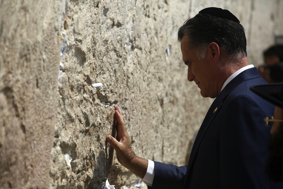 Click photo to download. Caption: Mitt Romney touches the Western Wall during his recent trip to Israel. Credit: Flash90.