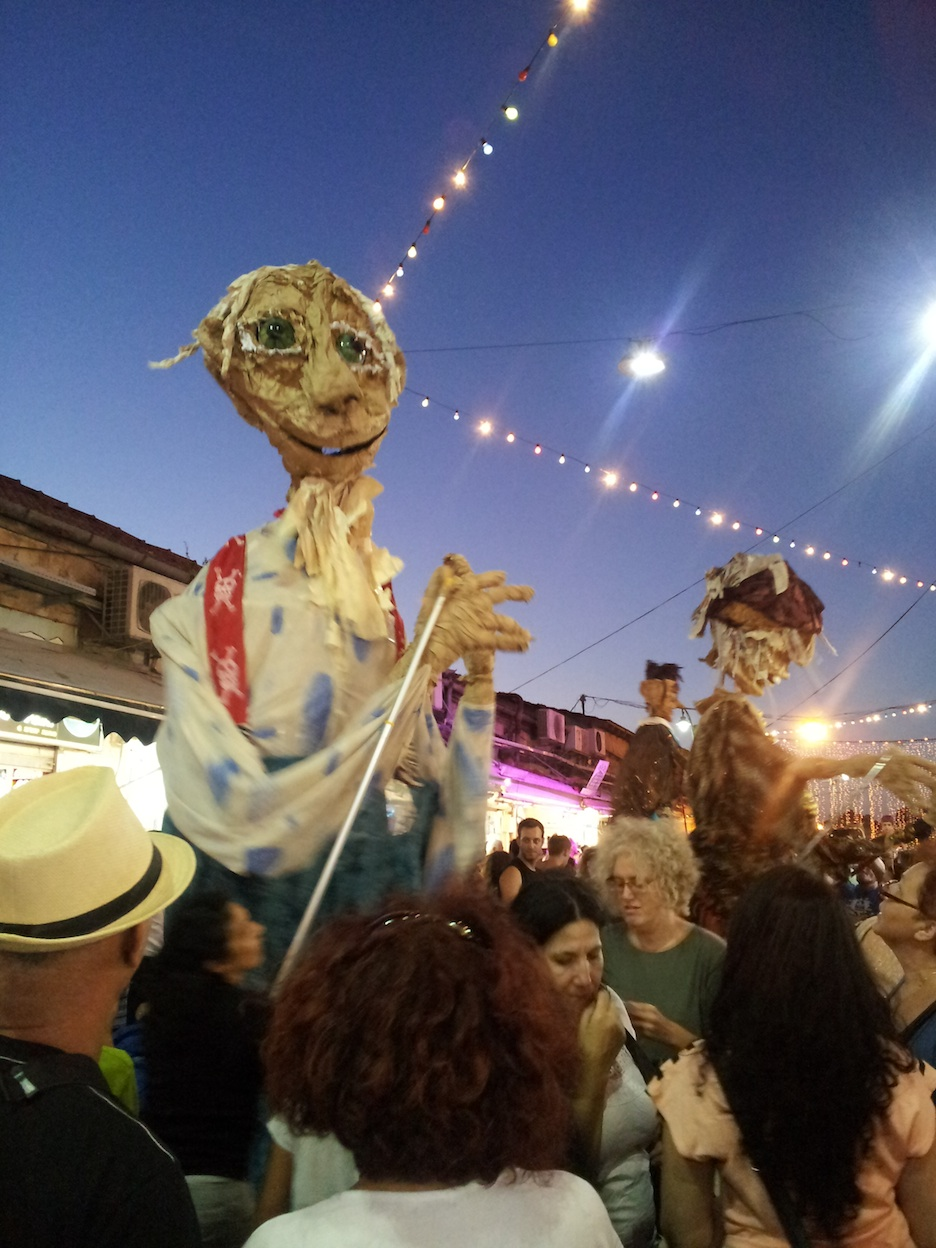 Click photo to download. Caption: A scene from this year's Balabasta festival in Jerusalem. Credit: Rachel Marder.