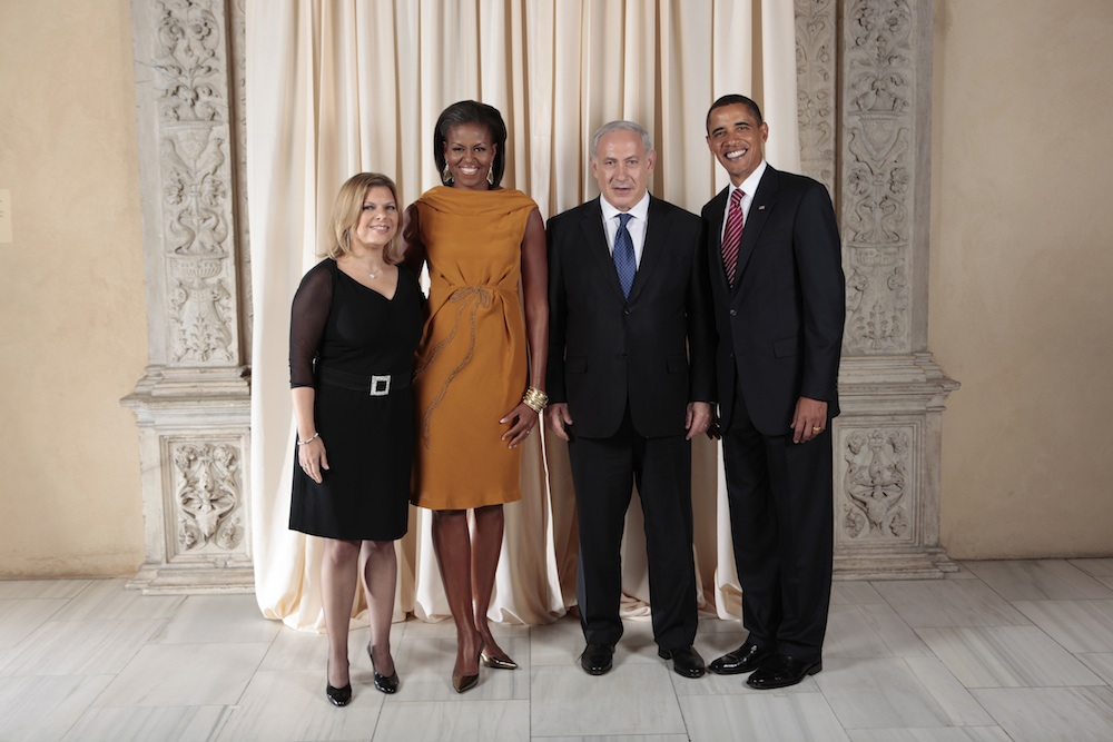 """Click photo to download. Caption: Prime Minister Benjamin Netanyahu and President Barack Obama pose with their wives. Netanyahu told Israel Hayom that he is not using the Iran issue to harm Obama's re-election bid, calling such claims """"complete nonsense."""" Credit: White House."""