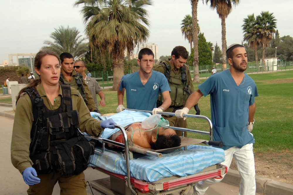 Click photo to download. Caption: Medics carry a man wounded by a mortar shell fired from the Gaza Strip, for treatment in Soroka hospital in Beersheba, southern Israel, Wednesday, Oct. 24, 2012. Credit: Dudu Greenspan/Flash90.