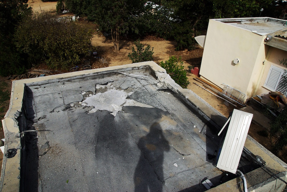 """Click photo to download. Caption: The damage from a direct hit by a Gaza rocket on an Eshkol Regional Council """"safe room"""" Nov. 16. Credit: Ronit Minaker."""
