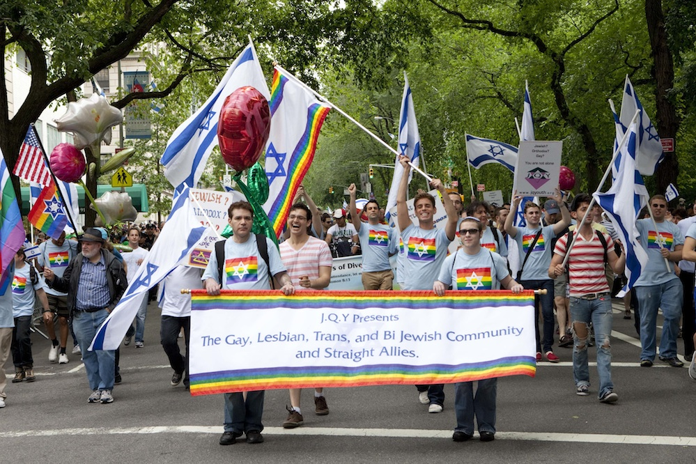 Click photo to download. Caption: A delegation from the nonprofit Jewish Queer Youth (JQY) marches in the 2012 Celebrate Israel Parade in New York City. It marked the first time since the parade was established in 1964 that a group explicitly representing lesbian, gay, bisexual and transgender (LGBT) Jews was allowed to march in the parade. Credit: JQY/Photographer Robert J. Saferstein.