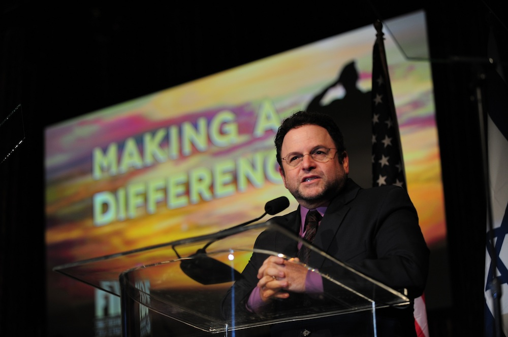 Click photo to download. Caption: Former Seinfeld star Jason Alexander speaks at the Dec. 6 Friends of the Israel Defense Forces gala in Los Angeles, for which he was the emcee. Credit: Alexi Rosenfeld.