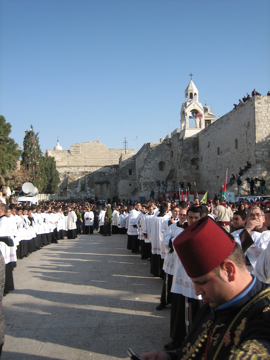 Click photo to download. Caption: A Catholic procession on Christmas Eve in Bethlehem, 2006. Credit: Darko Tepert/Wikimedia Commons.