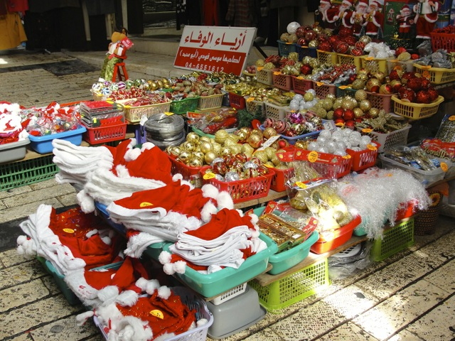 Click photo to download. Caption: Christmas decorations in Nazareth. Credit: Judy Lash Balint.