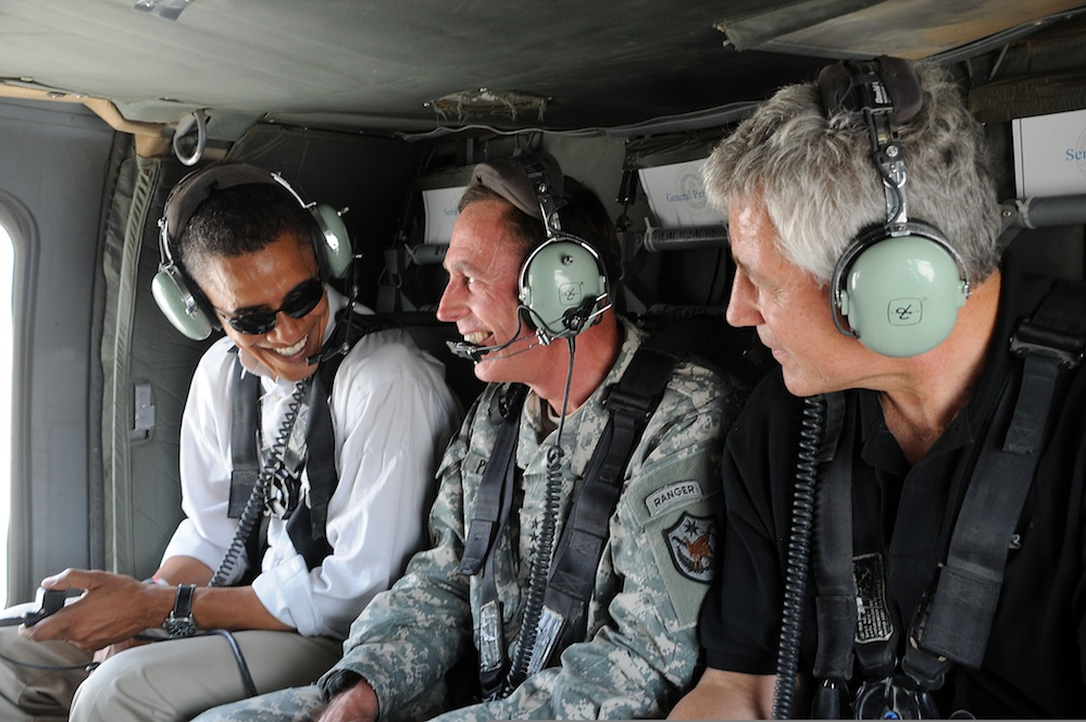 Click photo to download. Caption: In July 2008, U.S. Army Gen. David H. Petraeus (center), then commander of Multi-National Force-Iraq, gives an aerial tour of Baghdad to then Senators Barack Obama (far left) and Chuck Hagel (far right). Credit: U.S. Air Force/Staff Sgt. Lorie Jewell.