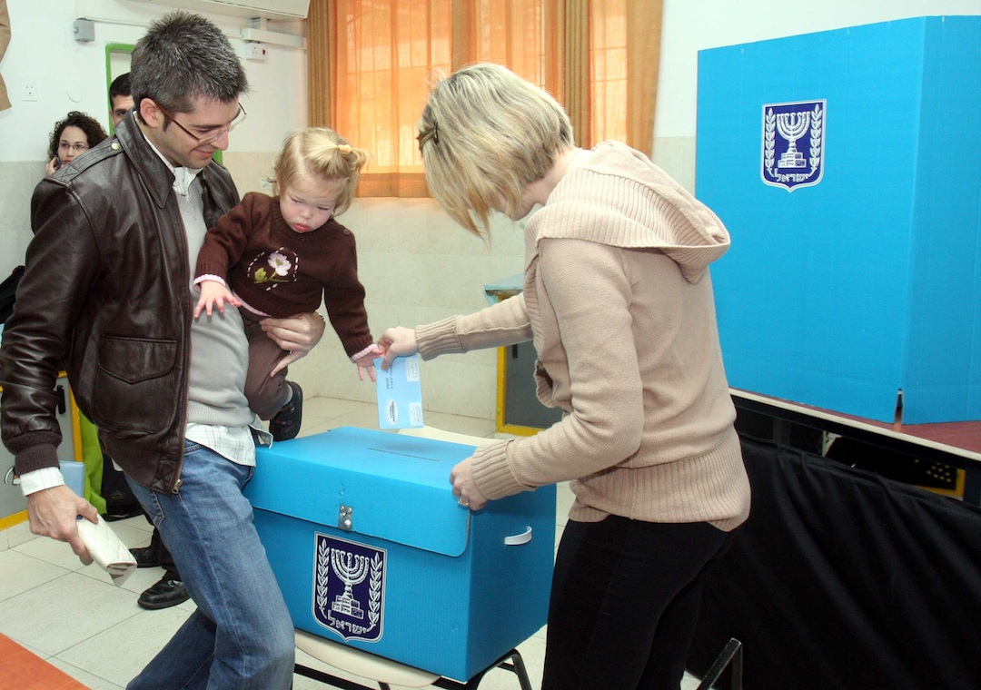 Click photo to download. Caption: An Israeli family casts a ballot at a polling station in Tel Aviv on Feb. 10, 2009. Credit: Flash90.