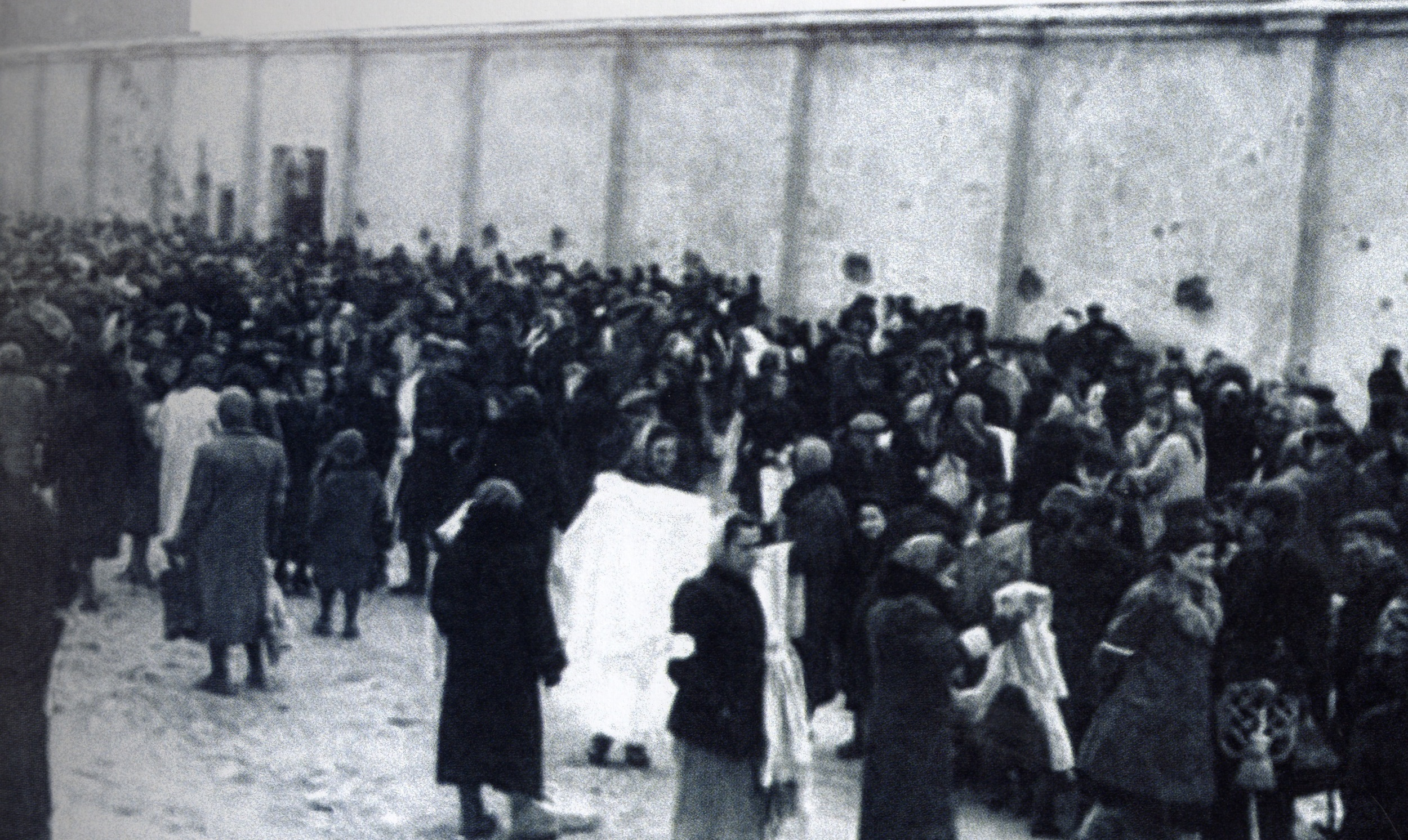 Click photo to download. Caption: Crowd near the wall of the Warsaw Ghetto. Credit:Photo courtesy of The David S. Wyman Institute for Holocaust Studies.