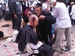 Click photo to download. Caption: A Hasidic man shaves his head in Uman, Ukraine, where he is joined by thousands of others from all over the world to observe Rosh Hashanah, as was requested by Rabbi Nachman before his death.