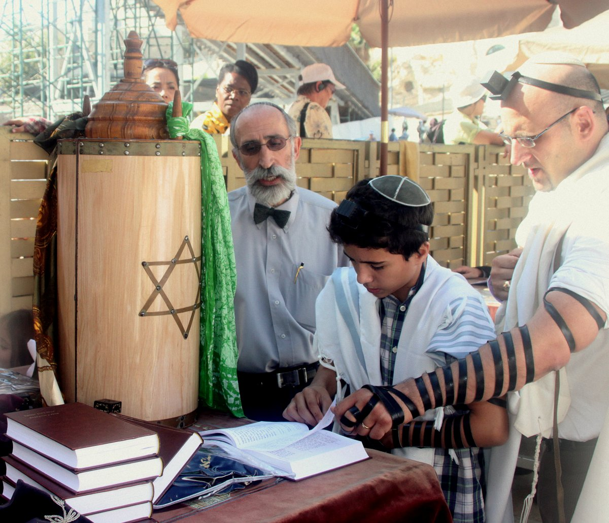 Click photo to download. Caption: A bar mitzvah boy reads his Torah portion at the Western Wall. Credit: Peter van der Sluijs/Wikimedia Commons.