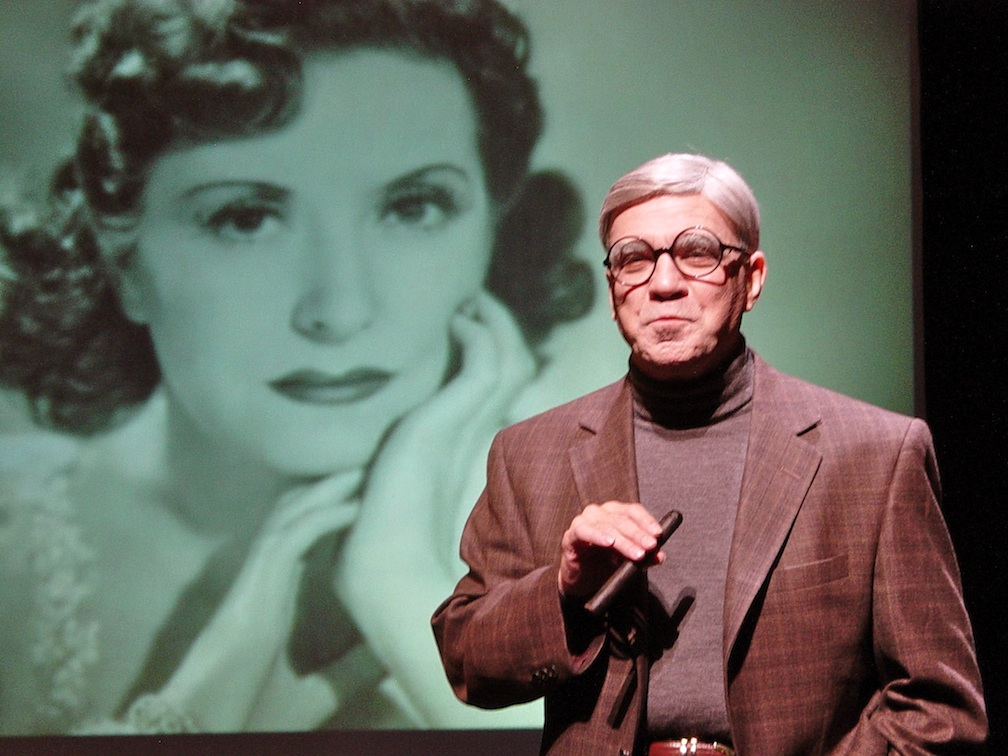"Click photo to download. Caption: Alan Safier as George Burns, with Gracie Allen in the background, in Safier's one-man show ""Say Goodnight Gracie."" Credit: Michael White."