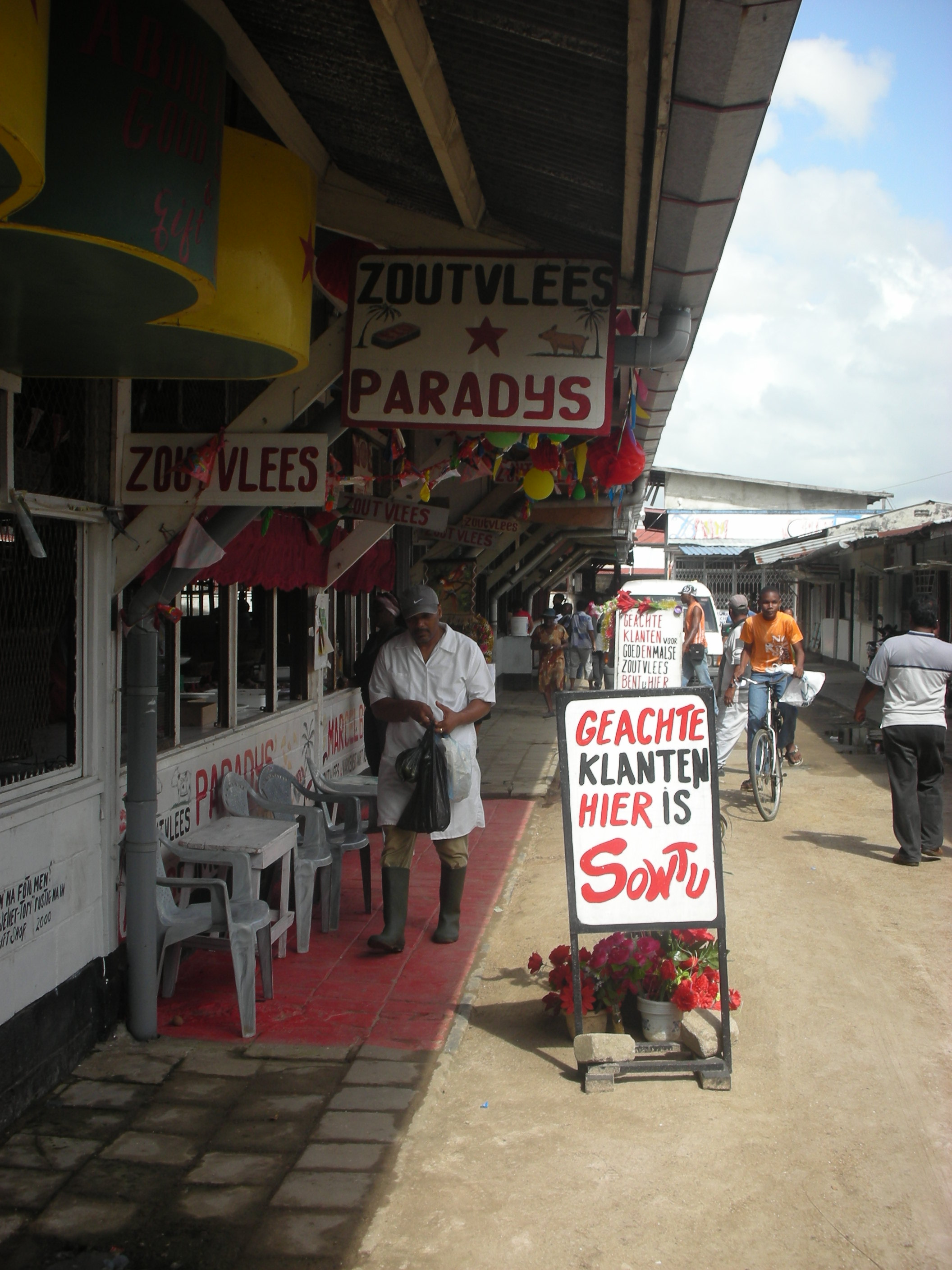 Click photo to download. Caption: A butcher market in Paramaribo. Credit: Bart van Poll.