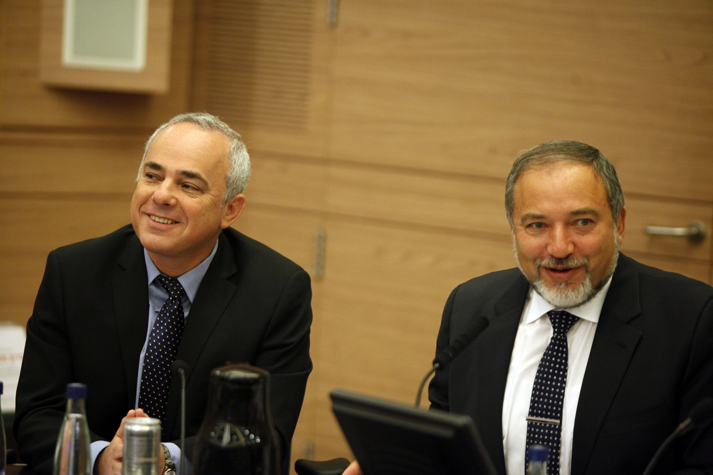 """Yuval Steinitz (left), Israeli Minister of International Relations and Strategic Affairs, and Avigdor Lieberman at a Foreign Affairs and Defence committee meeting in the Israeli Parliament in Jerusalem on May 20, 2013. Steinitz on Monday said There is a """"real possibility"""" that Syrian President Bashar al-Assad """"could survive Syria's civil war and even prevail in it."""" Credit: Flash90."""