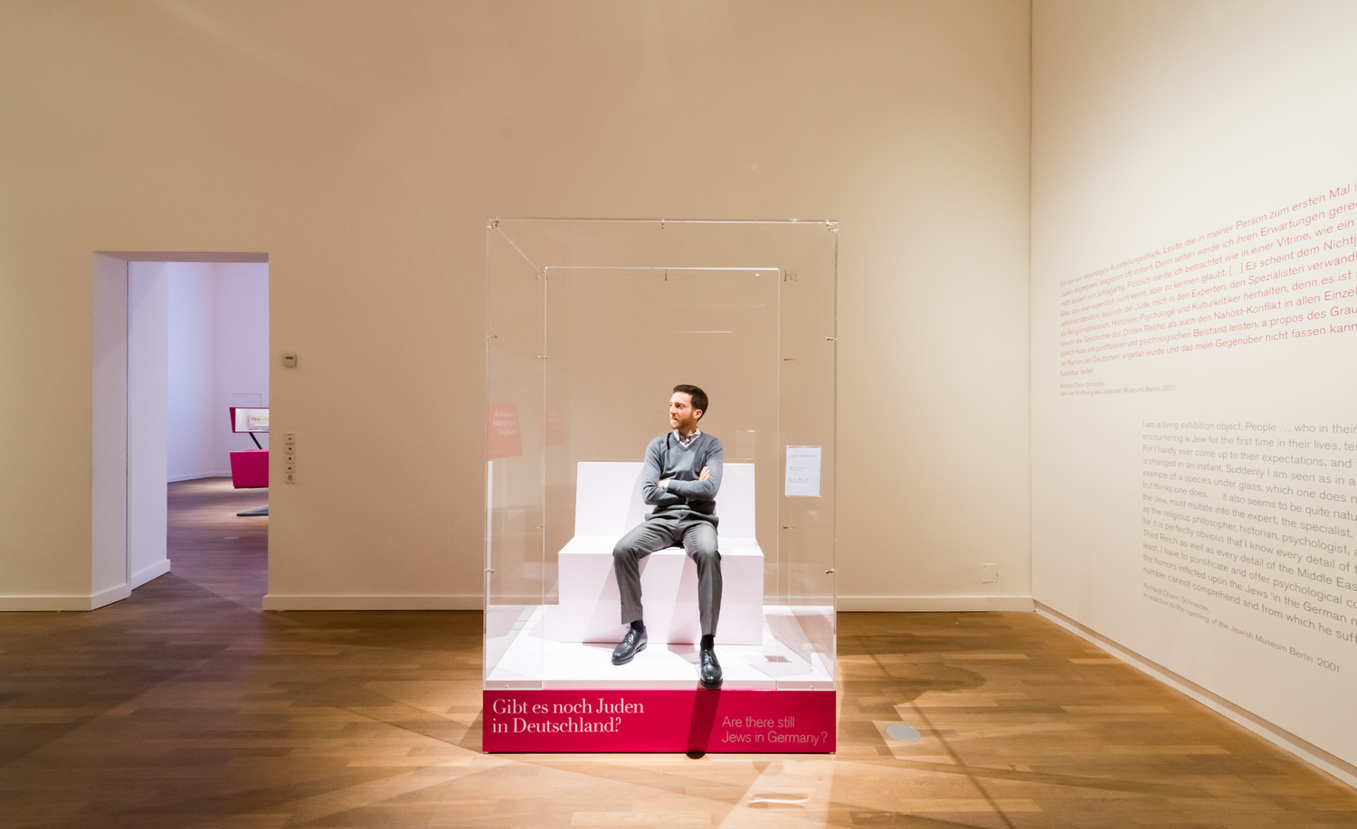 """Click photo to download. Caption: The Berlin Jewish Museum's """"The Whole Truth"""" exhibit, in whichJewish men and women sit in a glass box and answer questions from visitors about Judaism. Credit: © Jüdisches Museum Berlin/Linus Lintner."""