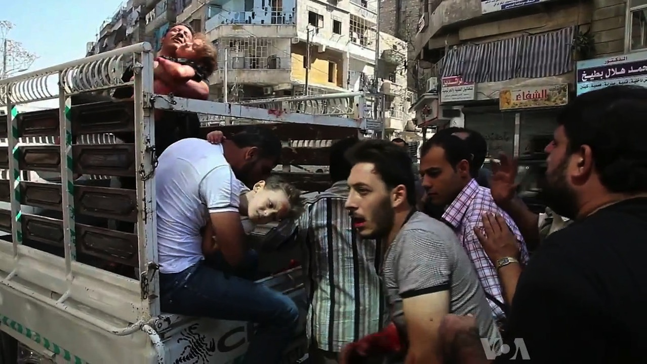 Click photo to download. Caption: Wounded civilians arrive at a hospital in Aleppo during the Syrian civil war. Credit: Voice of America News/Scott Bob via Wikimedia Commons.