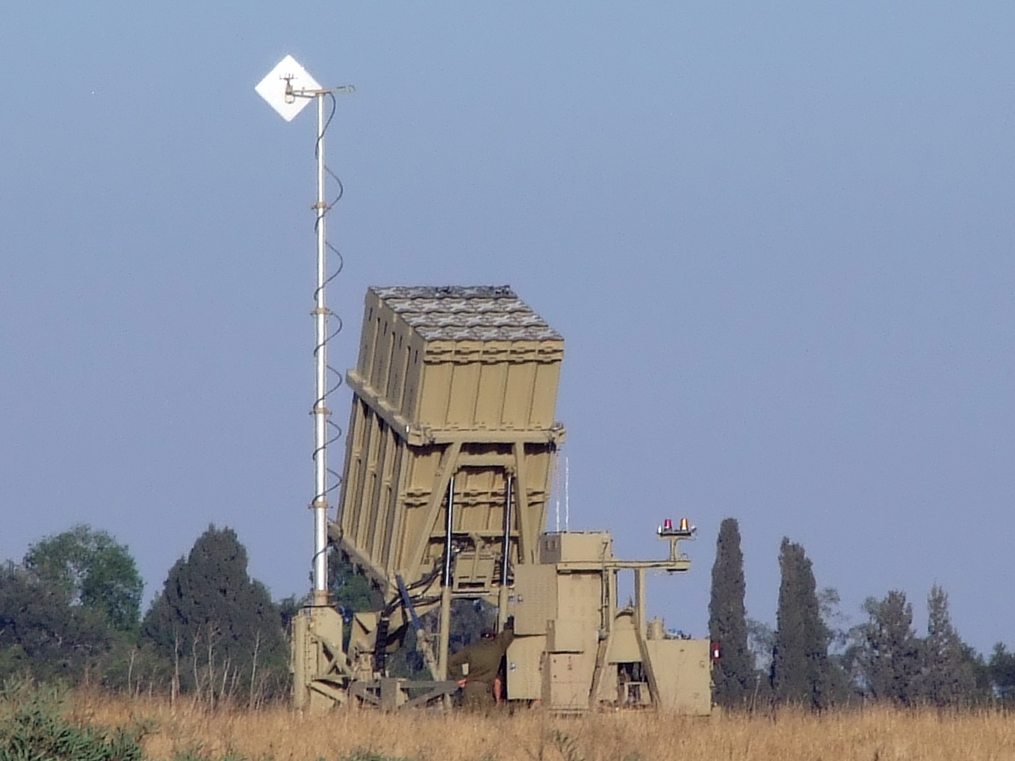 """The Israeli Iron Dome system, whose battery in Sderot is pictured, made its first successful rocket interception in Eilat. The Palestinian terrorist group behind the attack said afterward that Eilat """"will never enjoy security."""" Credit: NatanFlayer via Wikimedia Commons."""