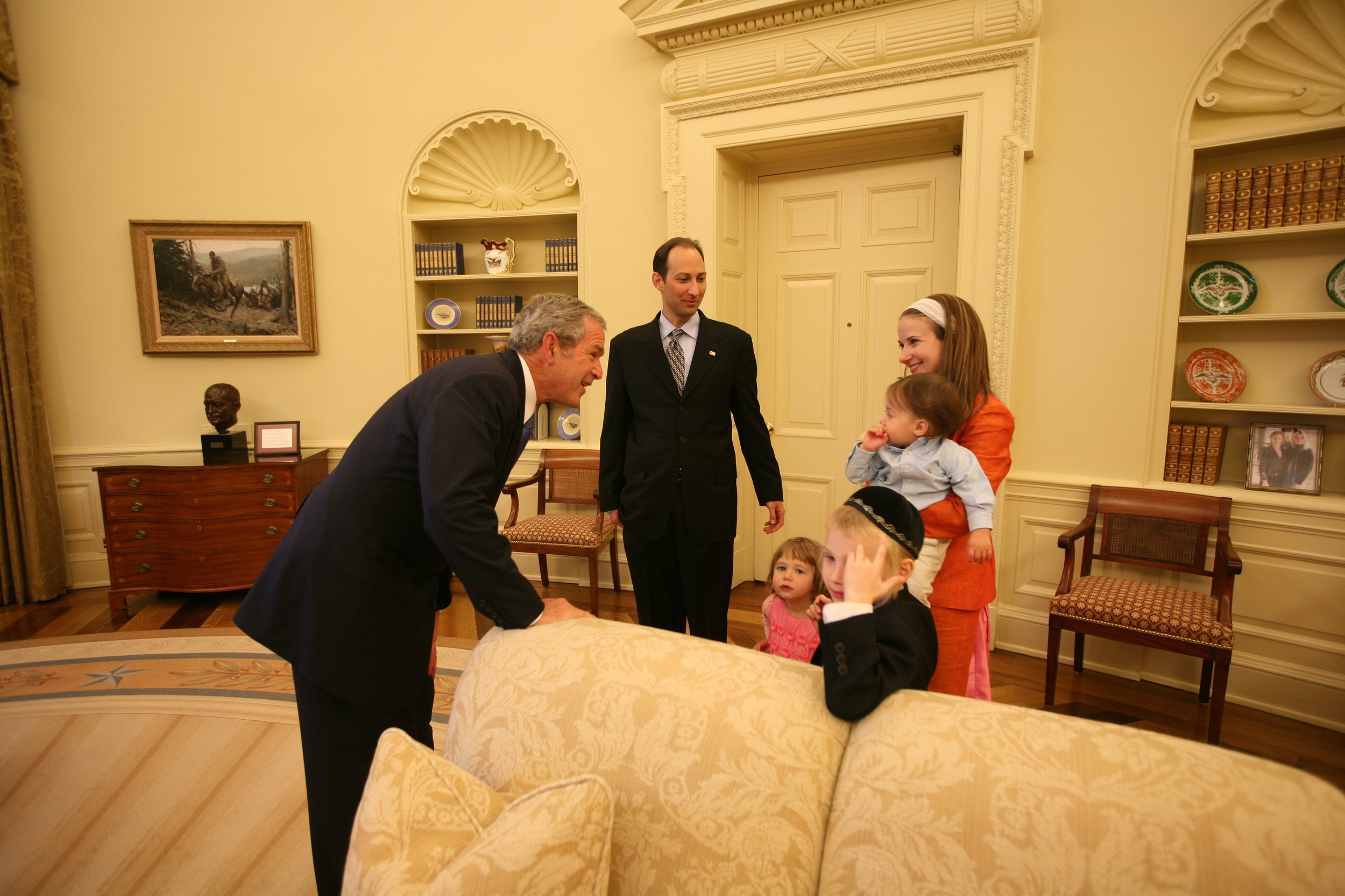 "Click photo to download. Caption: Tevi Troy (center, back)—author of  ""What Jefferson Read, Ike Watched, and Obama Tweeted: 200 Years of Popular Culture in the White House,"" —with his wife, Kami, children Ezra, Ruthie, Rina, and Noah, and President George W. Bush. Troy was Bush's liaison to the Jewish community. Credit: Courtesy Tevi Troy."