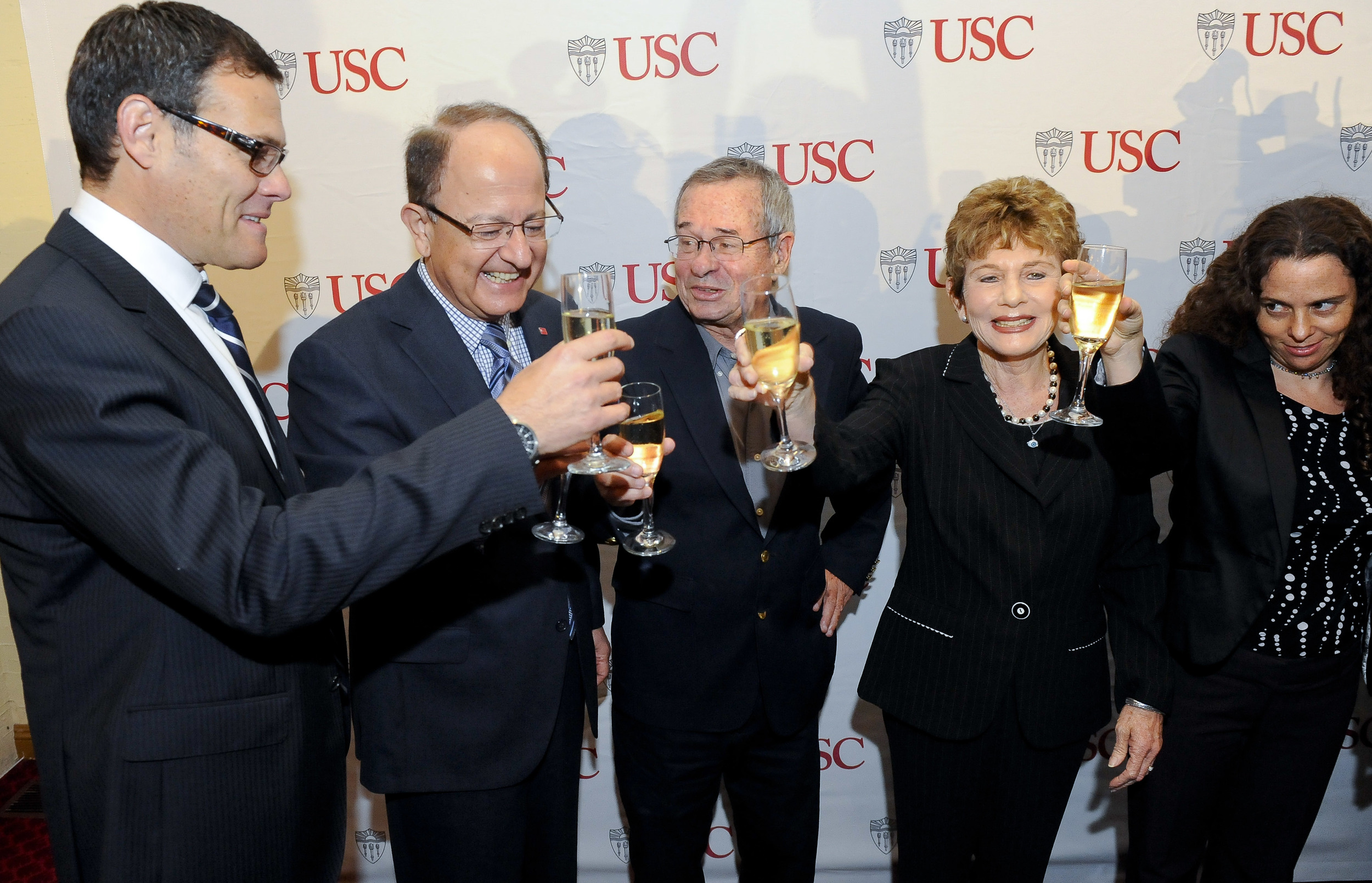 Click photo to download. Caption: Making a toast on Oct. 9 are (from left to right) Israeli Consul General David Siegel, University of Southern California (USC) President C. L. Max Nikias, 2013 Nobel Prize winner in chemistry USC Distinguished Professor Arieh Warshel, Warshe's wife Tami, and Warshel's daughter Yael. Credit: USC Photo/Gus Ruelas.