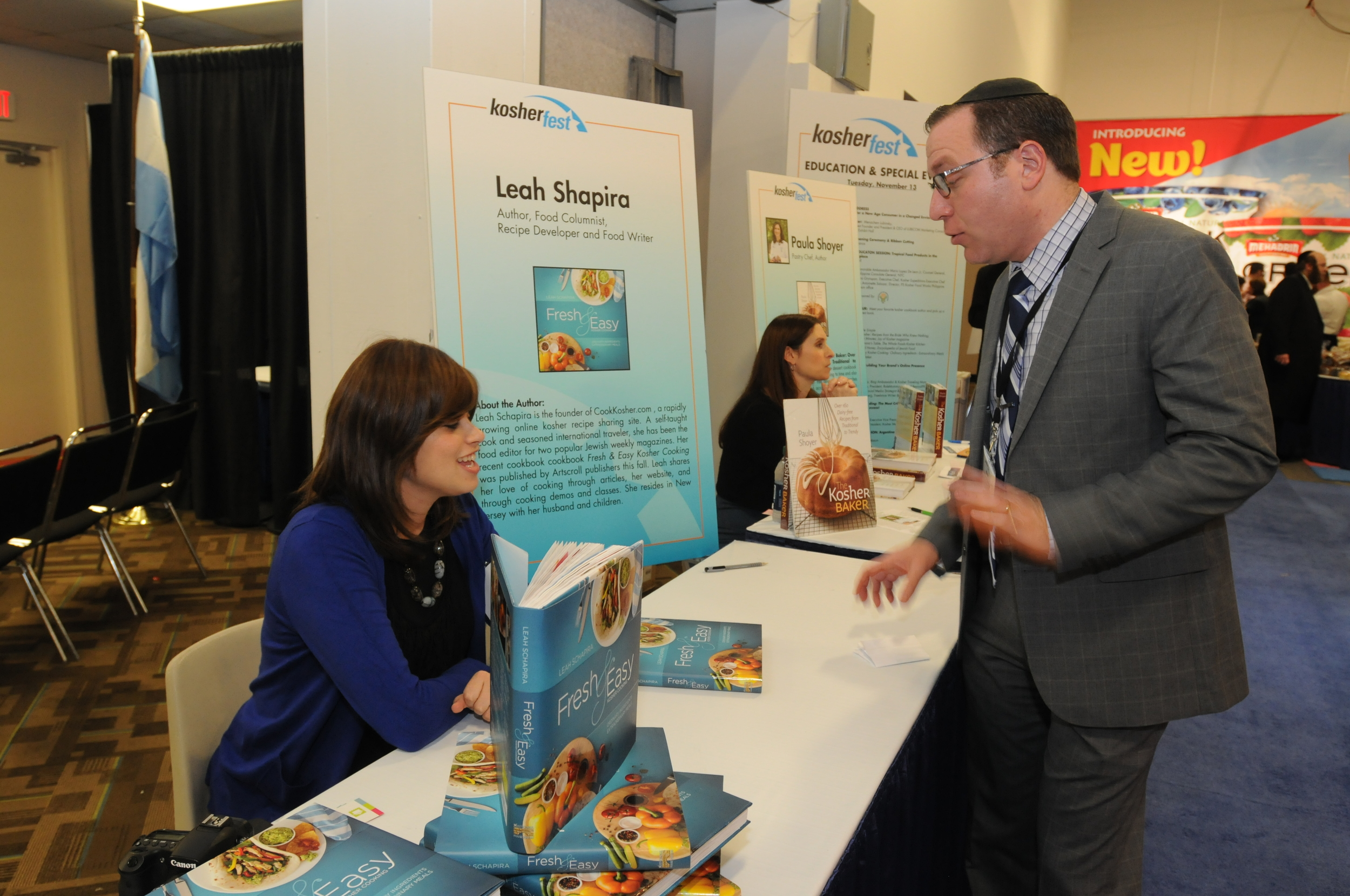"""Click photo to download. Caption: Leah Schapira exhibits her book, """"Fresh & Easy Kosher Cooking: Ordinary Ingredients, Extra-ordinary meals,"""" at Kosherfest 2013. Credit: Kosherfest."""