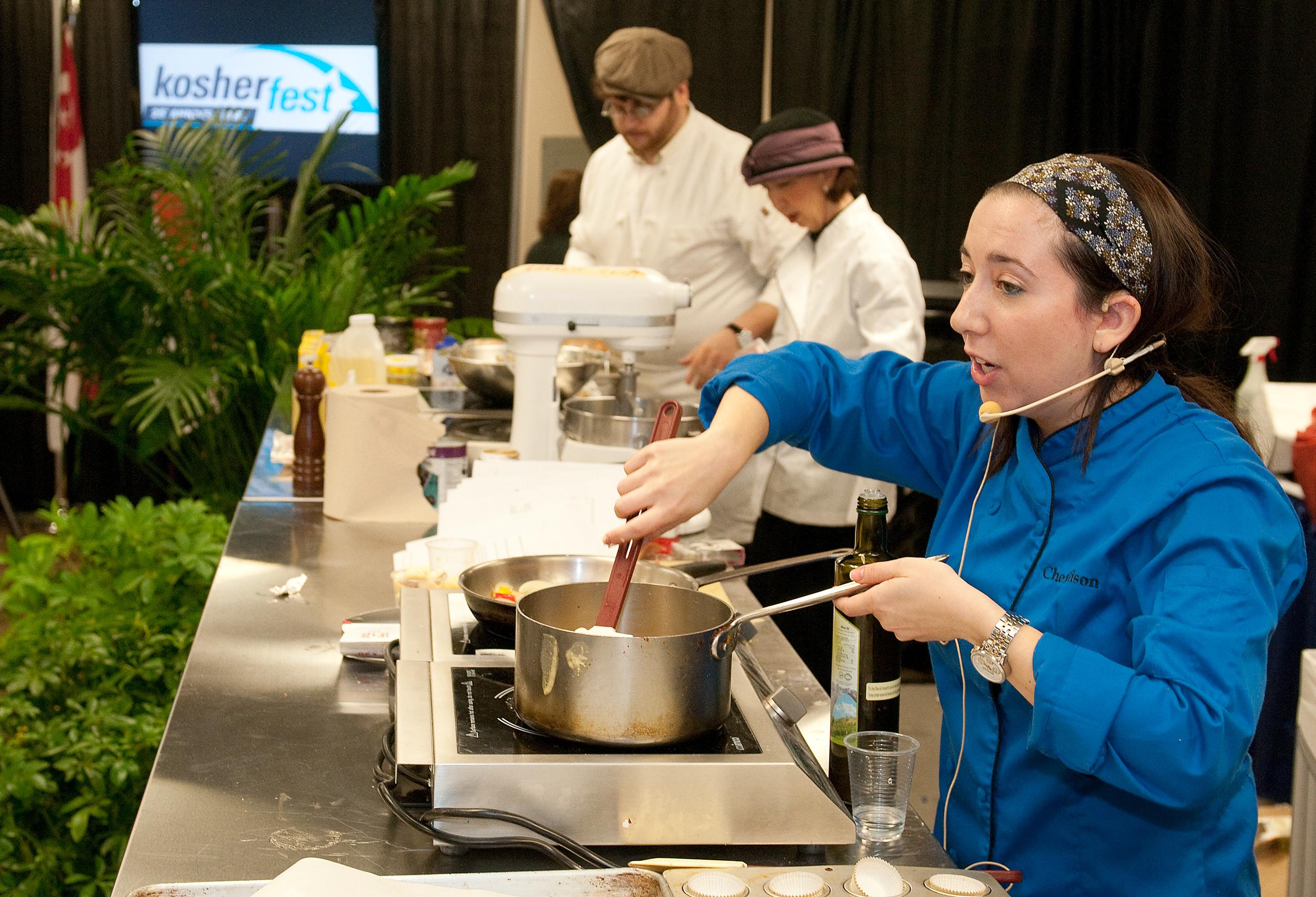 Click photo to download. Caption: A vendor cooks at Kosherfest 2013. Credit: Kosherfest.