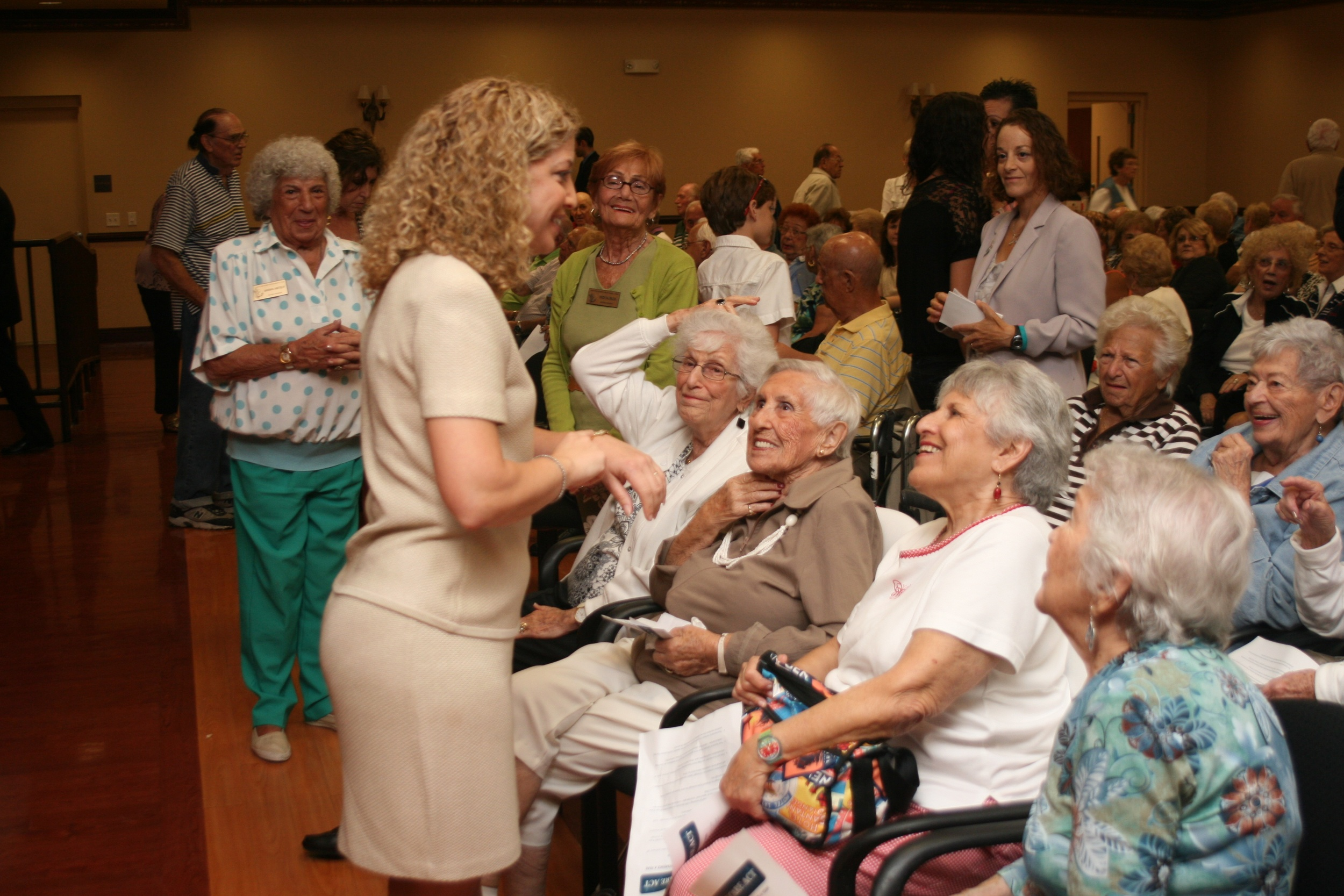 Click photo to download. Caption: Rep. Debbie Wasserman Schultz with senior citizens. Credit: Rep. Debbie Wasserman Schultz.