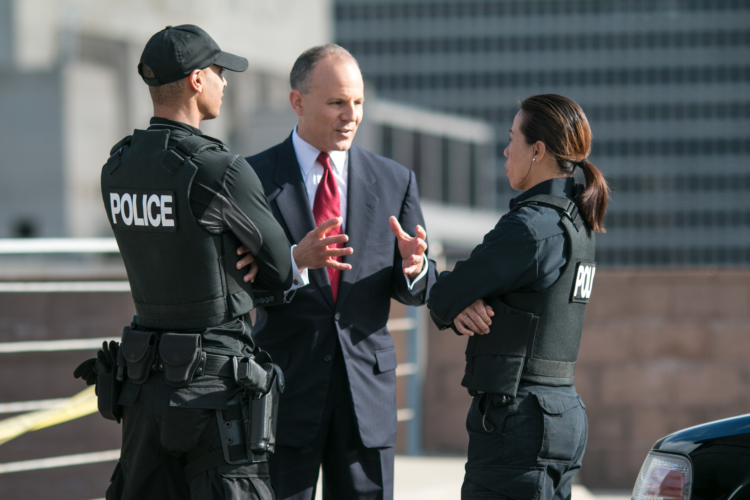 Click photo to download. Caption: Elan Carr with police officers. Credit: Provided photo.