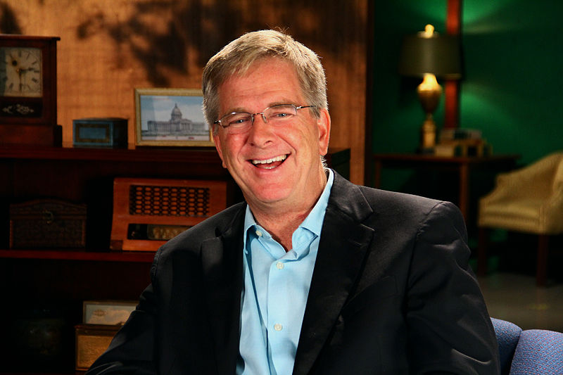 Click photo to download. Caption: TV travel show host Rick Steves. Credit: CarlosManzanoPHOTOs via Wikimedia Commons.
