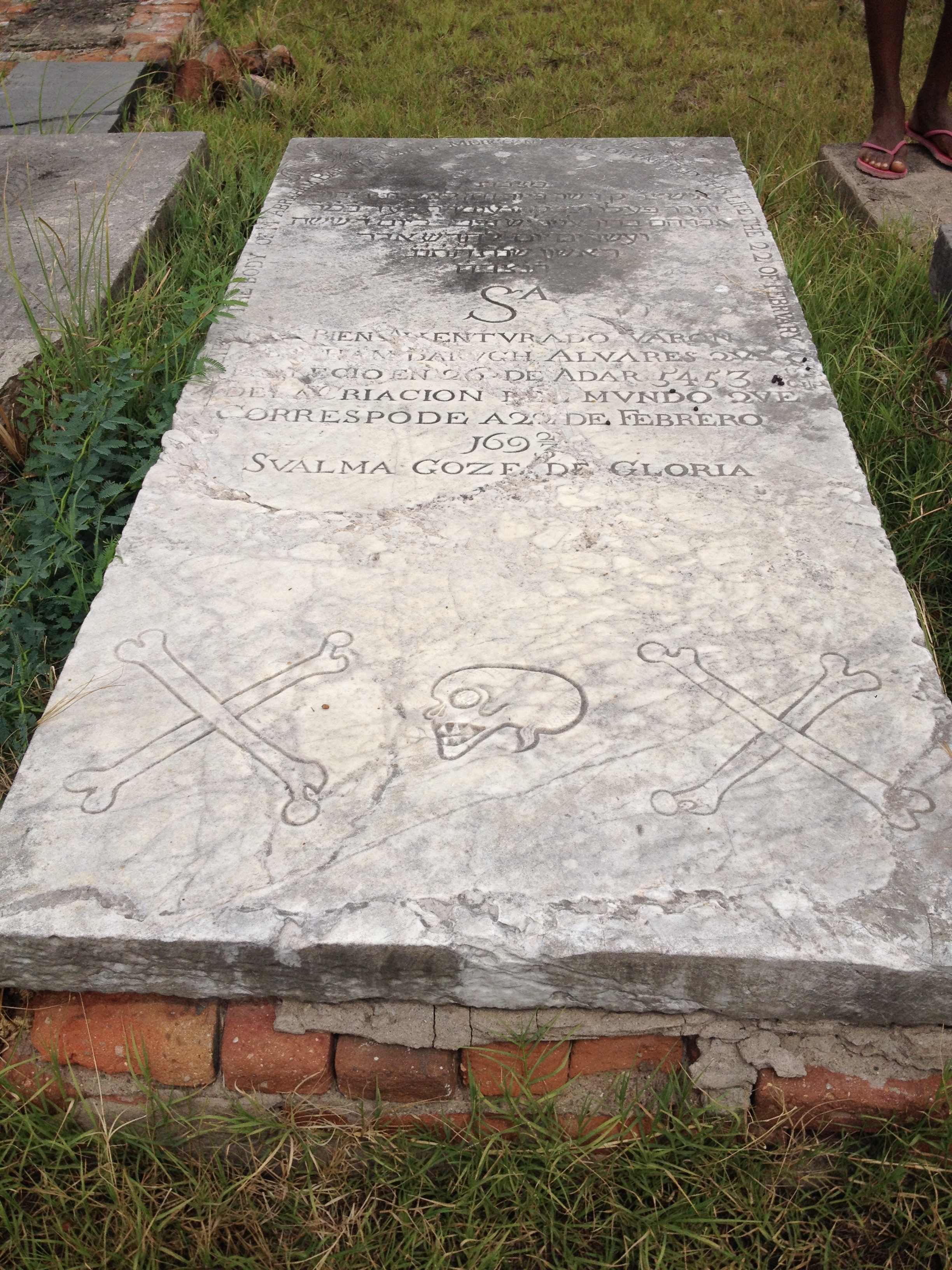 Click photo to download.Caption:A skull and crossbones is etched into a tombstone atJamaica's oldest Jewish cemetery in Hunt's Bay. Some scholars say this imagery relates to the Jewish pirates who protected Port Royal for the British. Credit: Maayan Jaffe.