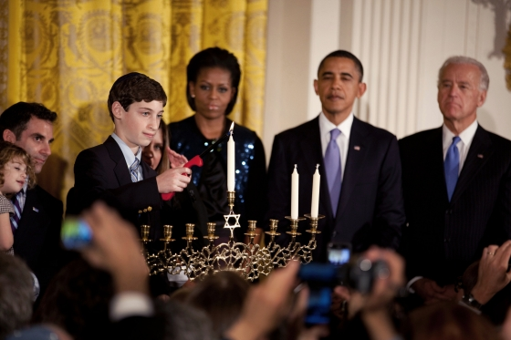 Click photo to download. Caption: First Lady Michelle Obama, President Barack Obama, and Vice President Joe Biden look on during the Hanukkah menorah lighting ceremony at the White House in December 2010. Credit: White House photo by Chuck Kennedy.