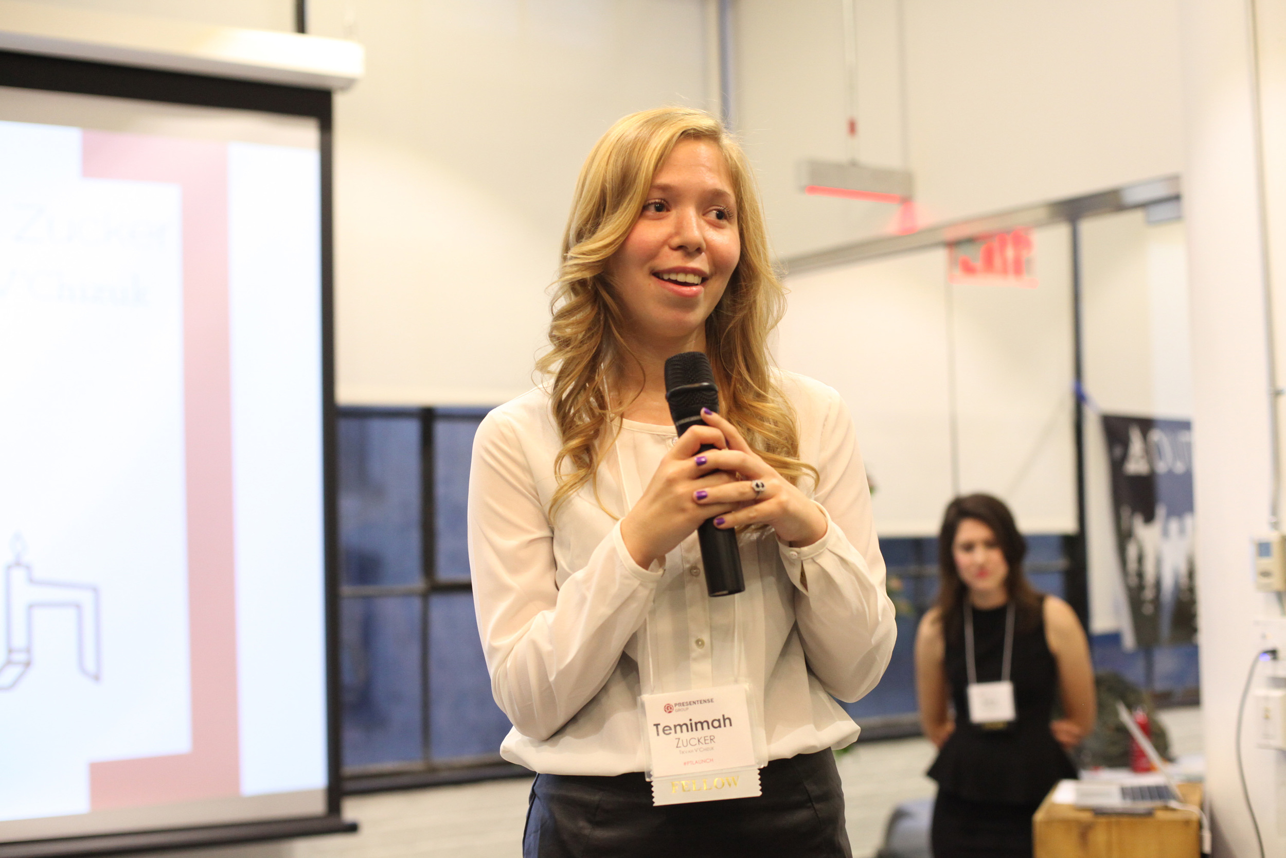 Click photo to download. Caption: Temimah Zucker, a 24-year-old activist working to tackle eating disorders in the Jewish community, gives a presentation. Credit: Courtesy of Temimah Zucker.
