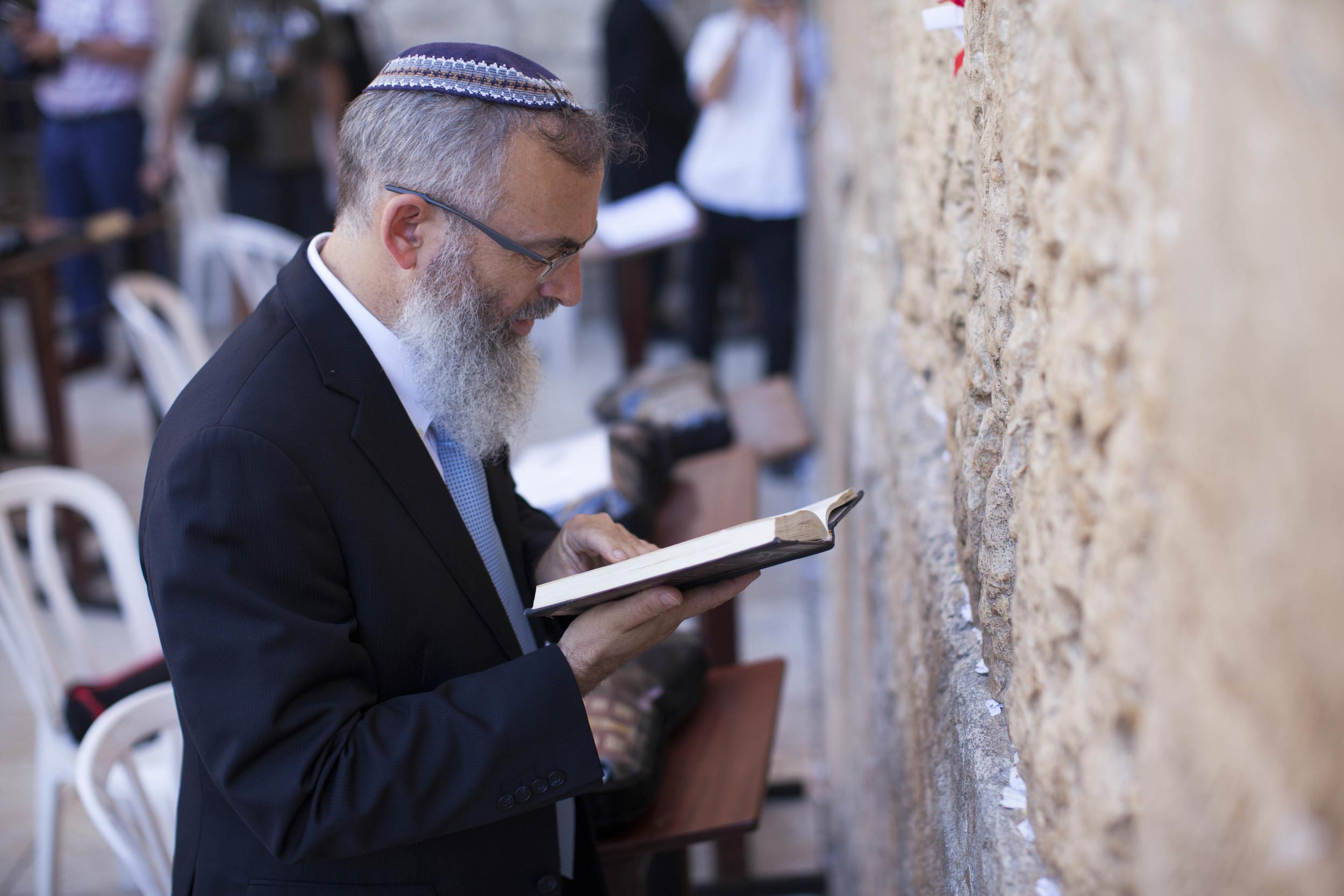 Click photo to download. Caption: Rabbi David Stav visits the Western Wall in Jerusalem on July 24, 2013. Credit: Yonatan Sindel/Flash90.