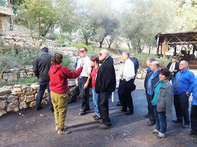 Click photo to download. Caption: The LOTEM-Making Nature Accessible organization trains b lindfolded Israeli bus drivers to better serve people with disabilities. Credit: Jewish National Fund.