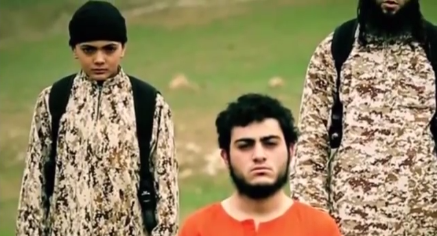 """Islamic State's latest execution video, released Tuesday, identifies the pictured victim (wearing orange) as a 19-year-oldIsraeli Arab and a """"Mossad spy."""" Credit: YouTube screenshot."""