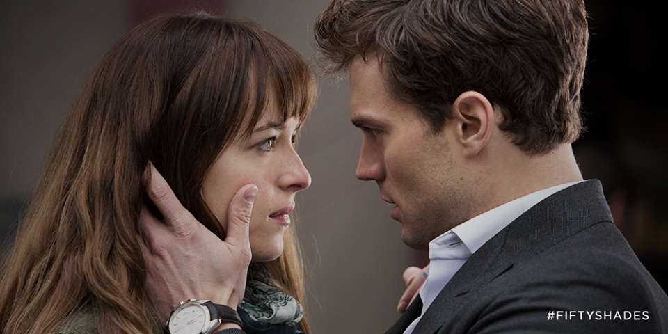 "Click photo to download. Caption: Anastasia Steele (played by Dakota Johnson) and Christian Grey (played by Jamie Dornan) in ""Fifty Shades of Grey."" Credit: Universal Pictures."