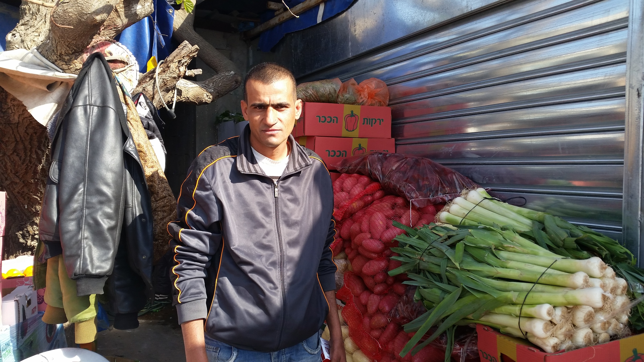 "Click photo to download. Caption: Fadi (pictured), a Palestinian man from a village neighboring Ariel, said Israeli leaders and political parties are "" all the same"" and ""can't help us with anything."" Credit: Orit Arfa."