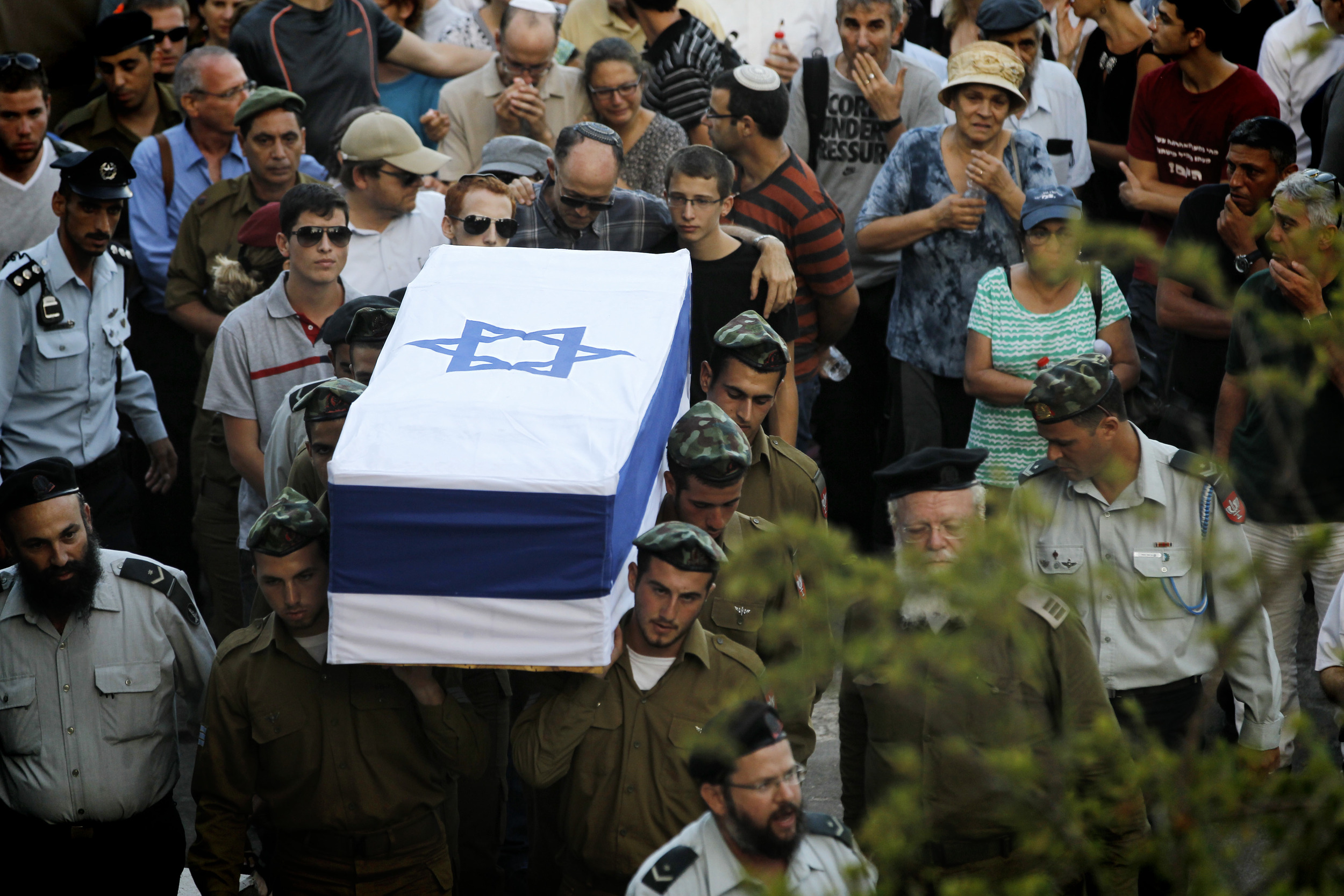 Click photo to download. Caption: Friends and relatives mourn at the funeral of IDF Sgt. Barkey Ishai Shor on Mount Herzl in Jerusalem on July 29, 2014. Shor was one of 66 Israeli soldiers killed during last summer's war with Hamas. Credit: Miriam Alster/Flash90.