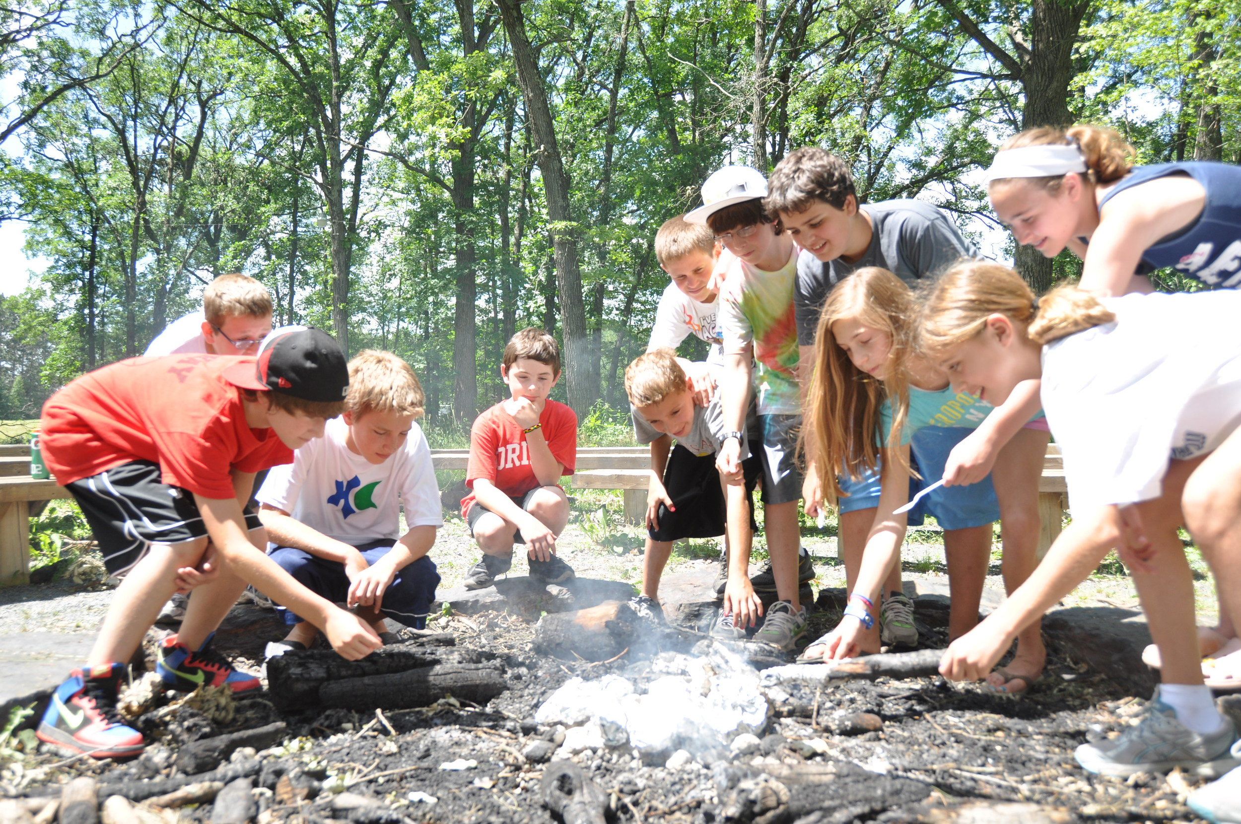 Click photo to download. Caption: A campfire at Webster, Wisconsin-based Herzl Camp,aJCamp180-supported summer camp. Credit: Herzl Camp.