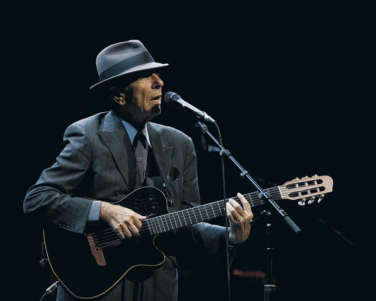 Click photo to download. Caption: Leonard Cohen in concert. Credit: Leonard Cohen press photo.
