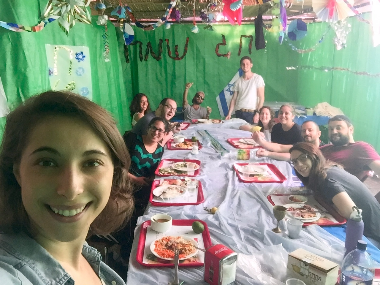 Click photo to download. Caption: Eliana Rudee in the sukkah with her ulpan classmates. Credit: Courtesy Eliana Rudee.