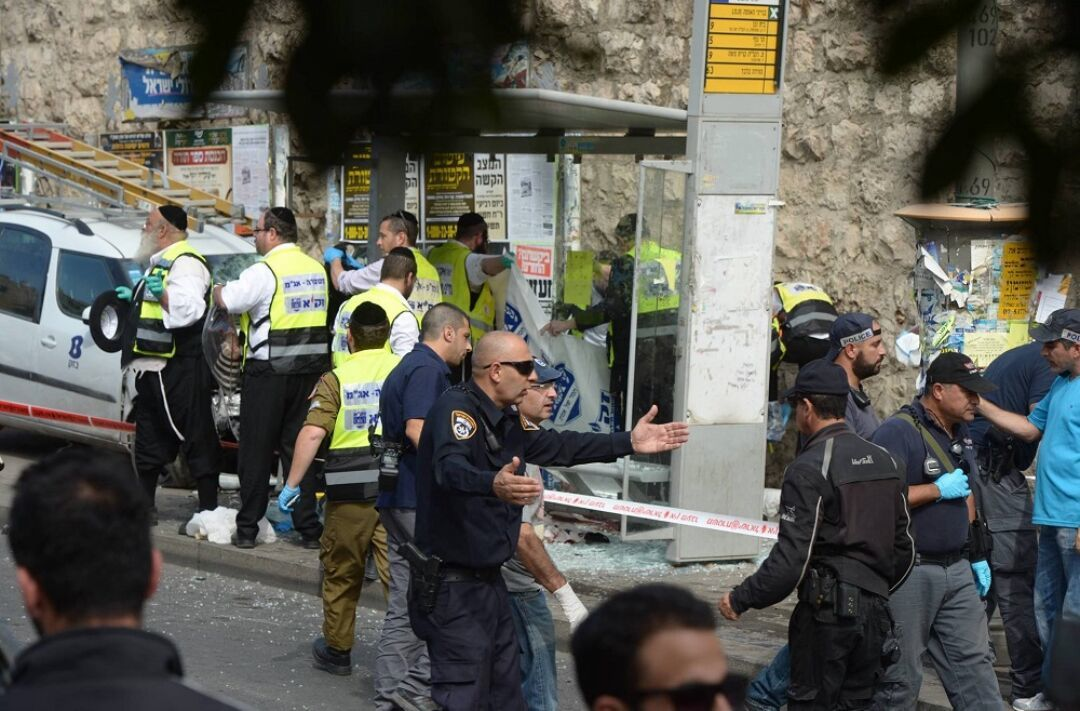 Click photo to download. Caption: ZAKA volunteers respond to a recent car-ramming attack on Malchei Yisrael Street in Jerusalem. Credit: Courtesy ZAKA.