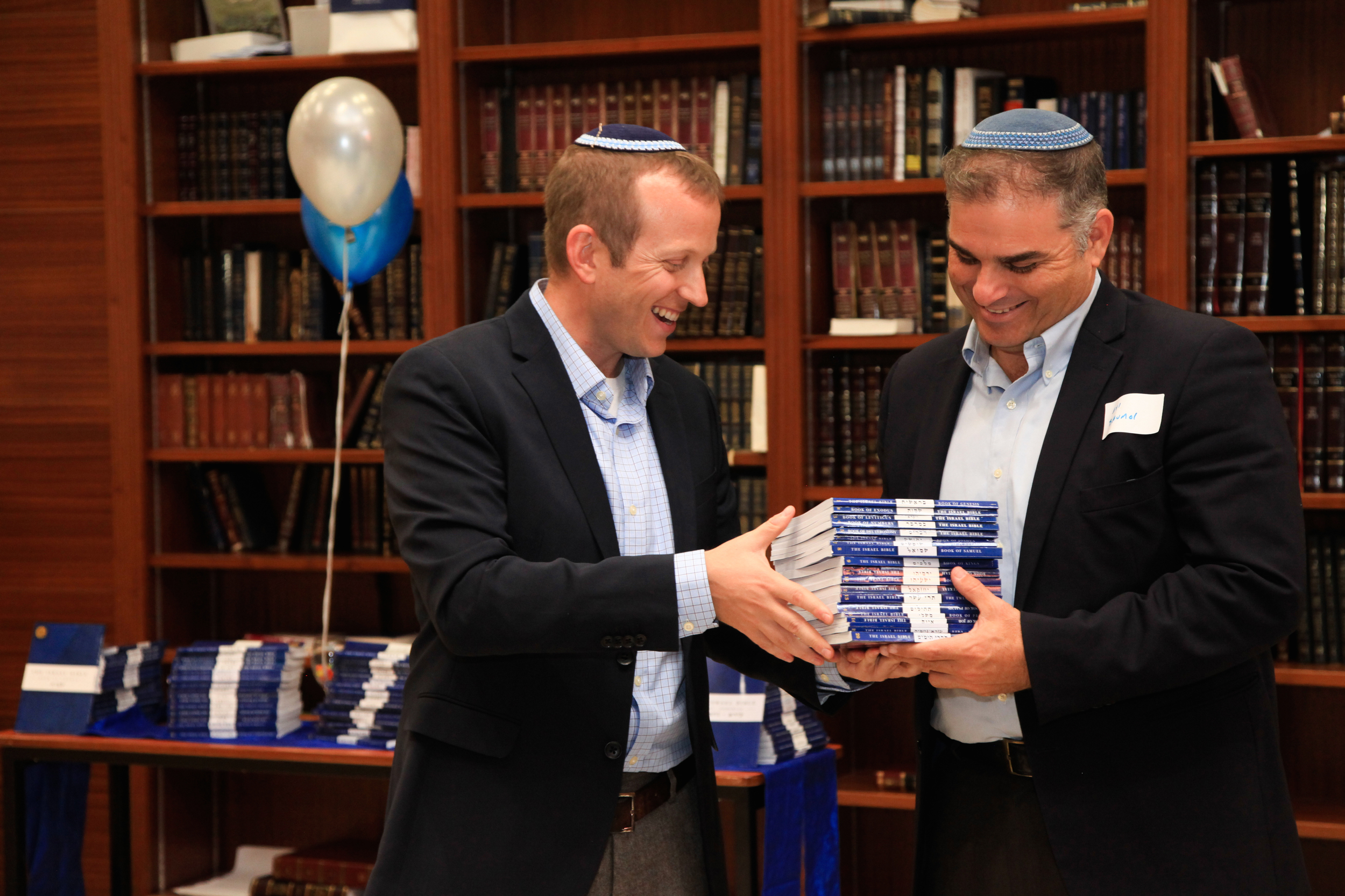 """Click photo to download. Caption: Rabbi Tuly Weisz (left) presents a set of """"The Israel Bible"""" to Rabbi Avi Baumol. Credit: Israel365."""