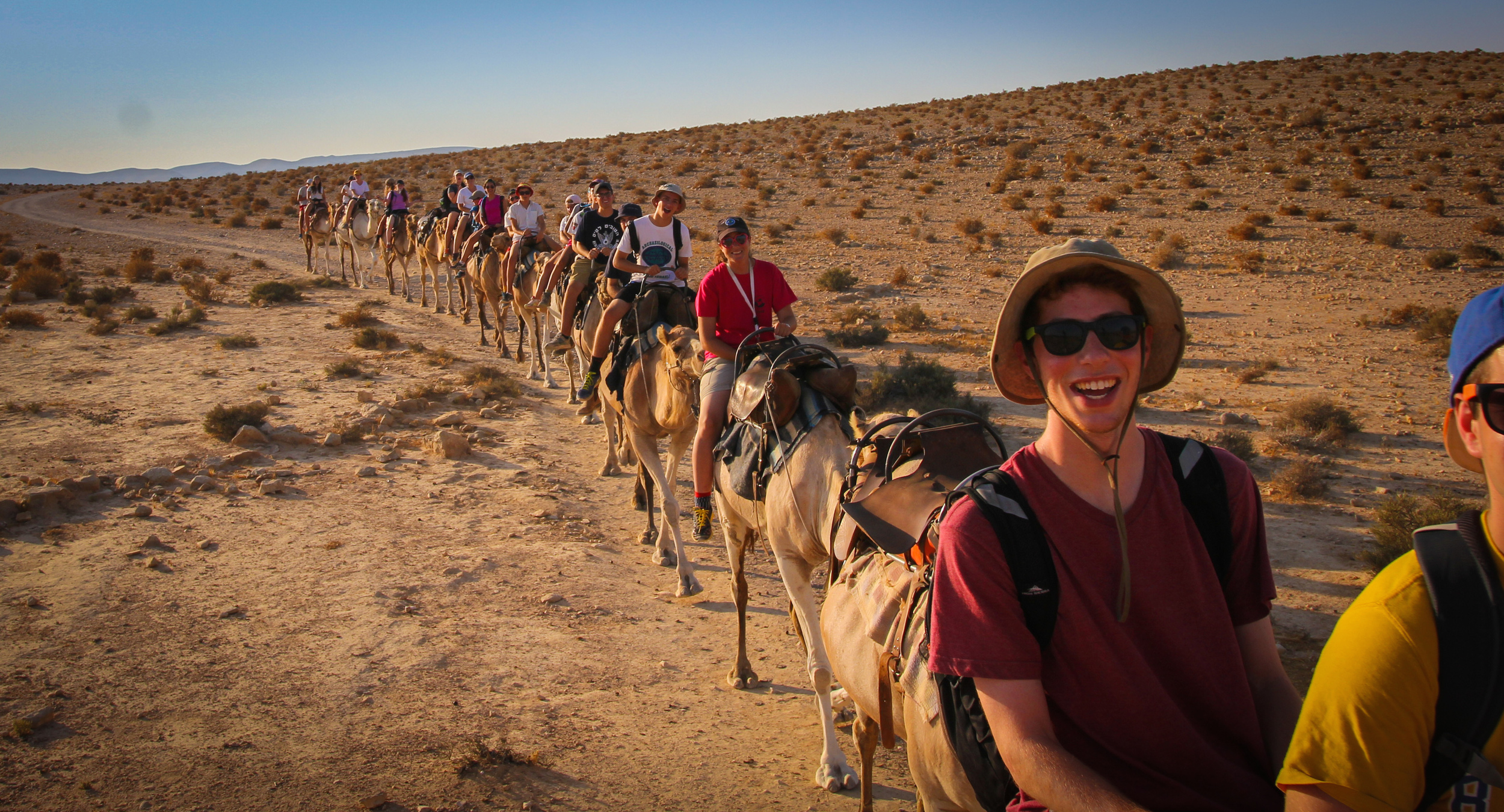 Click photo to download. Caption: Participants of Ramah's Israel summer camp experience ride camels. Credit: Ramah Commission.
