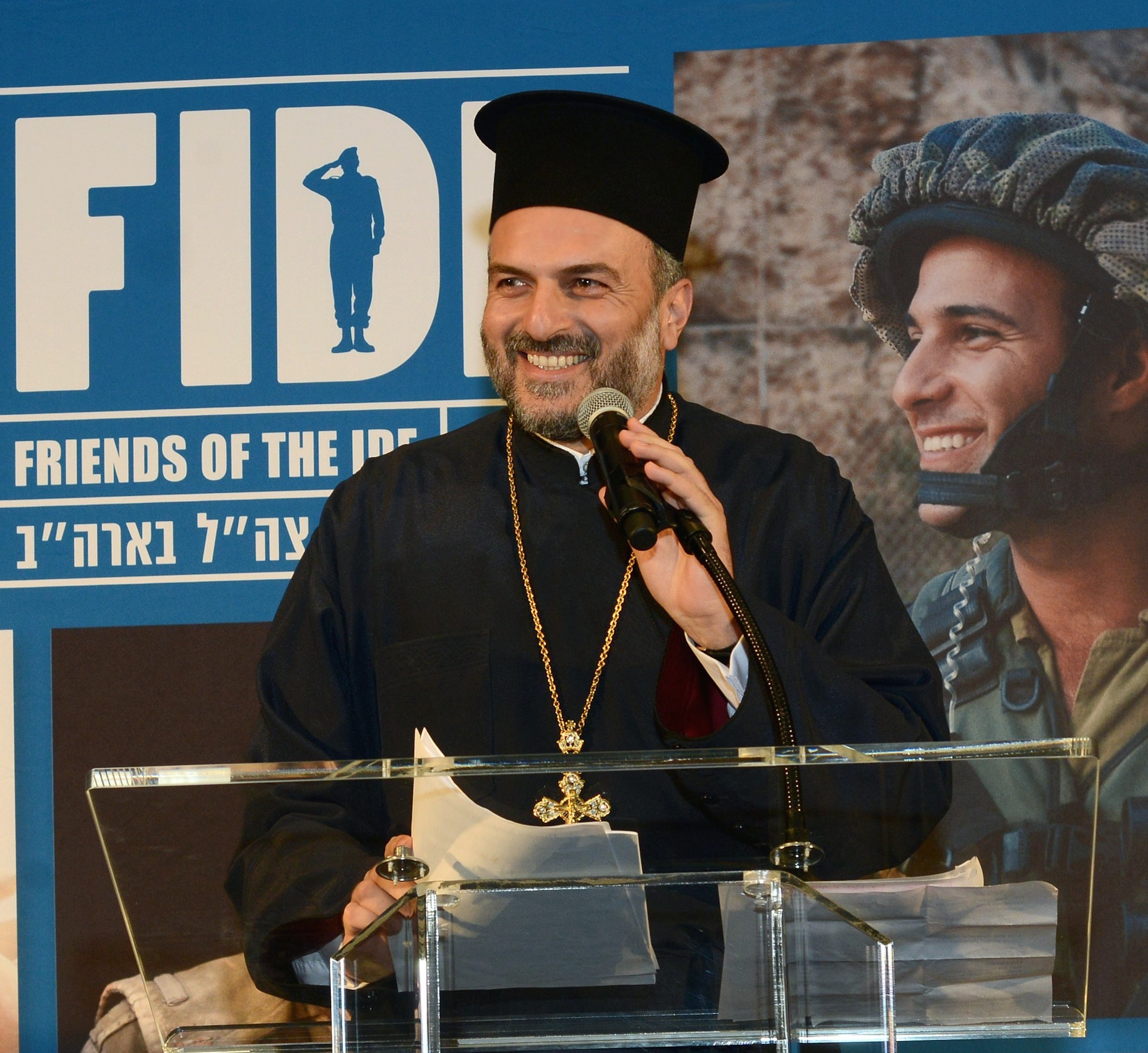Click photo to download. Caption: Father Gabriel Naddaf, a prominent Israeli Christian leader,addresses the Friends of the Israel Defense Forces Texas Region gala on March 28 in Houston. Credit: Alan Ross.