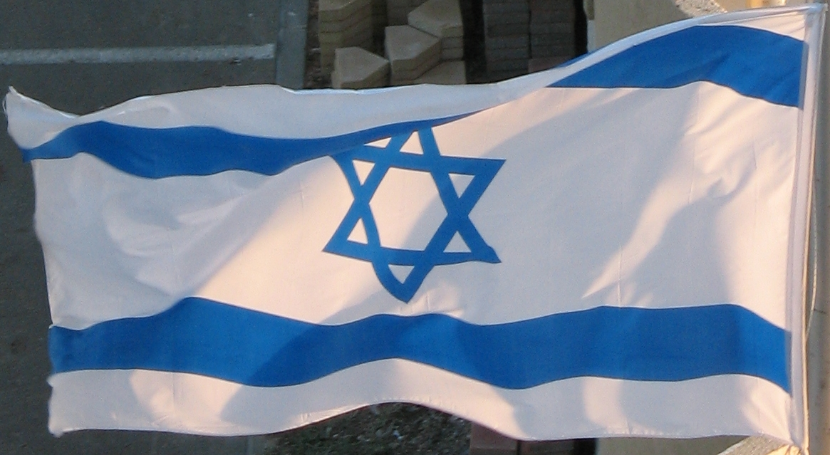 Click photo to download. Caption: An Israeli flag. Credit: James Emery via Wikimedia Commons.