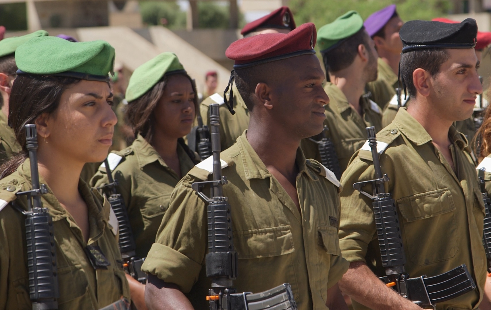 Click photo to download. Caption: Mekonen Abebe (front, in center) graduates from IDF officer training school. Credit: Jerusalem U.